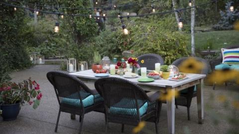 Outdoor patio table set for dinner.